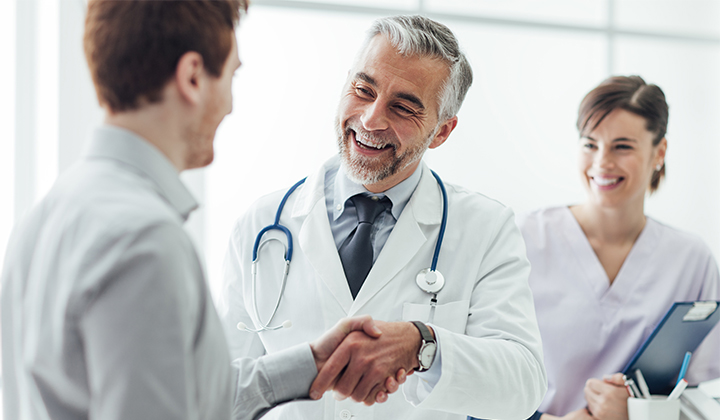 Doctor shaking man's hand.